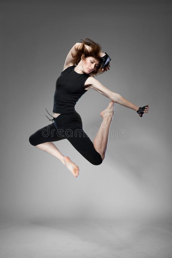 Attractive jumping woman royalty free stock images