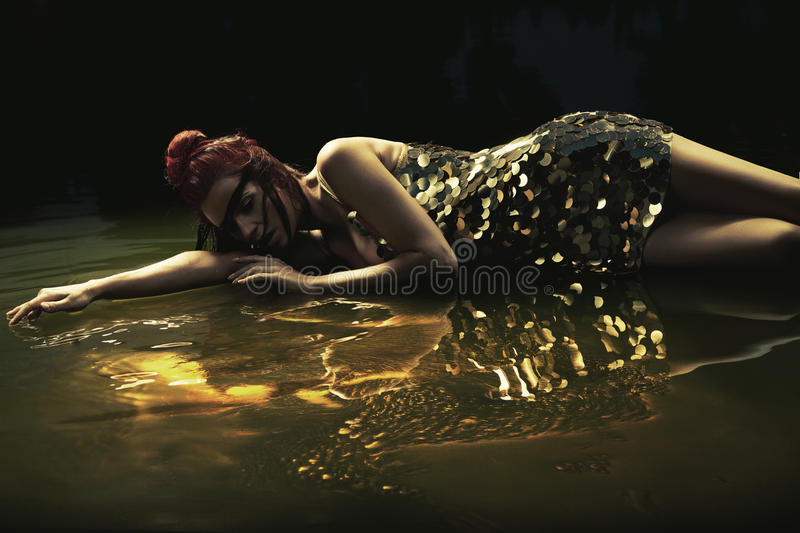 Download Attractive Lady Lying In Liquid Chocolate Stock Photo - Image: 26942252