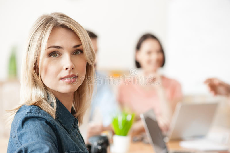 Attractive lady is working with her team royalty free stock photography