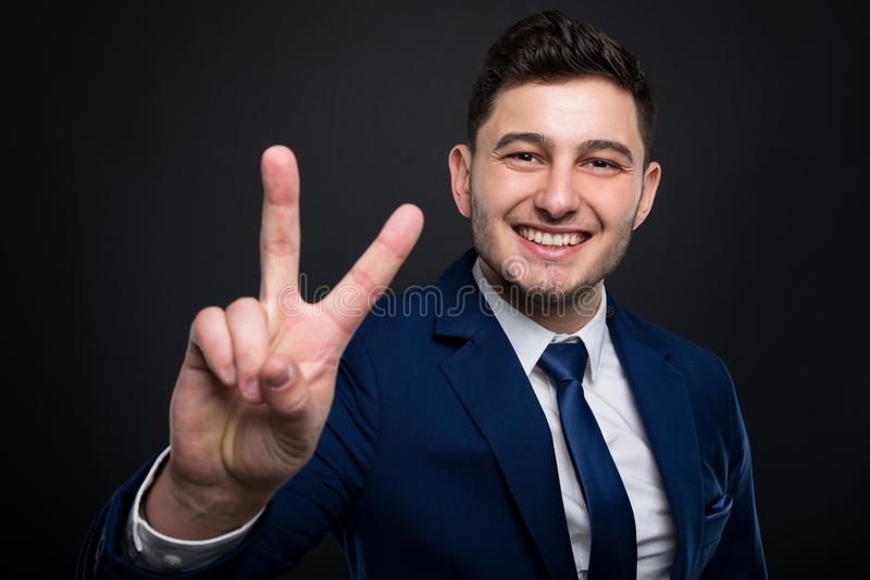 Attractive lawyer in suit shows sign of peace stock images