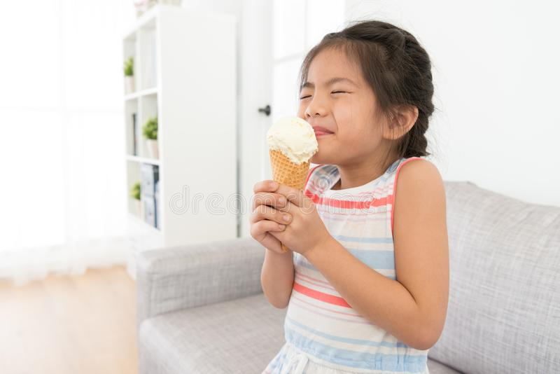 Attractive little girl children eating ice cream royalty free stock photography