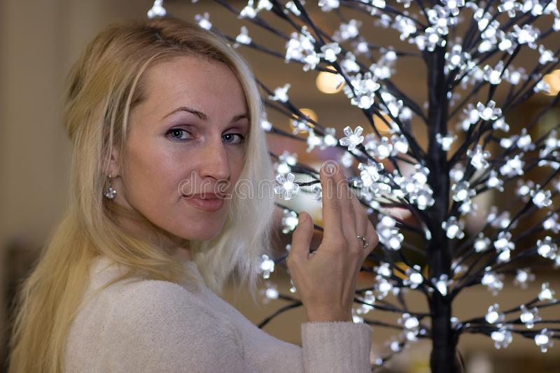 Attractive long hair woman celebration Christmas. Attractive blonde long hair woman celebration Christmas royalty free stock images