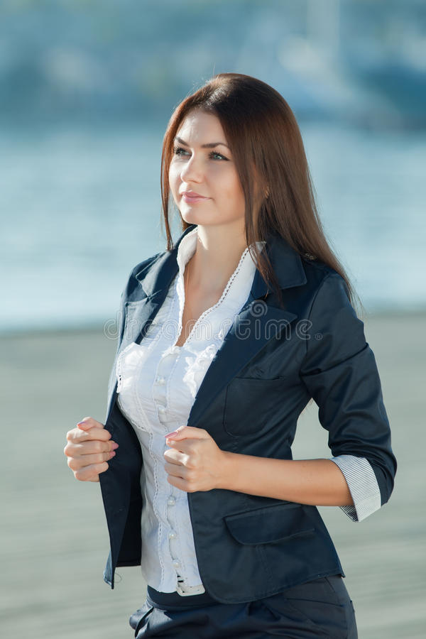 Attractive long haired brunette on open air stock photos