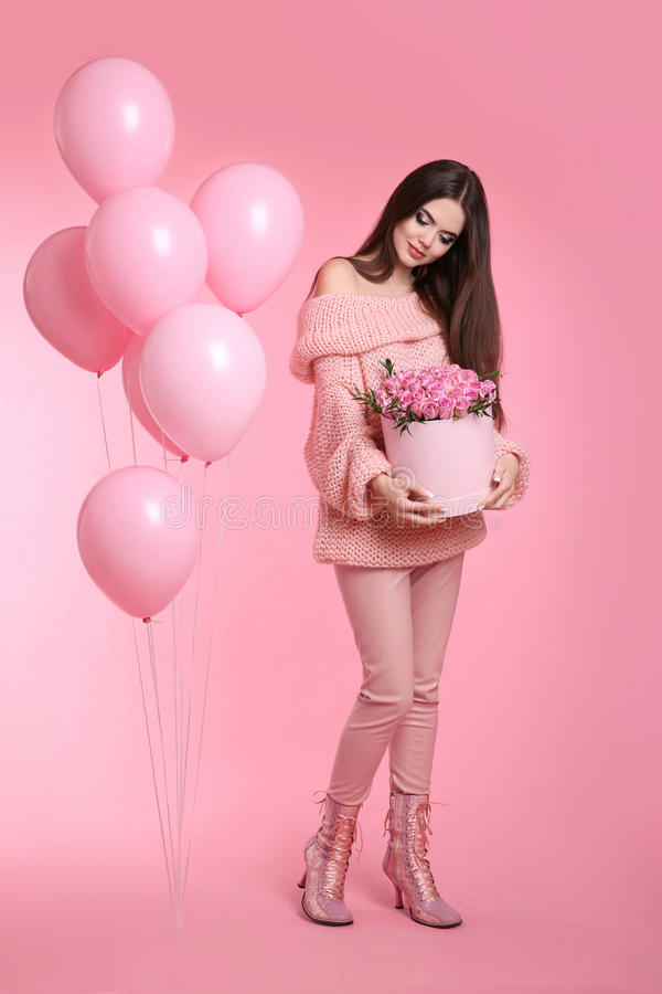 Attractive love teen brunette with balloons holding bouquet of r stock images