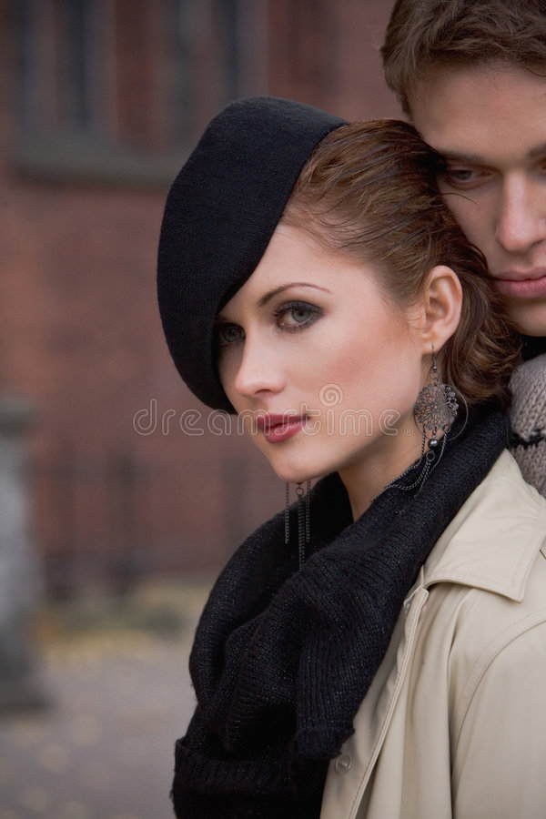 Attractive loving couple outside stock photo