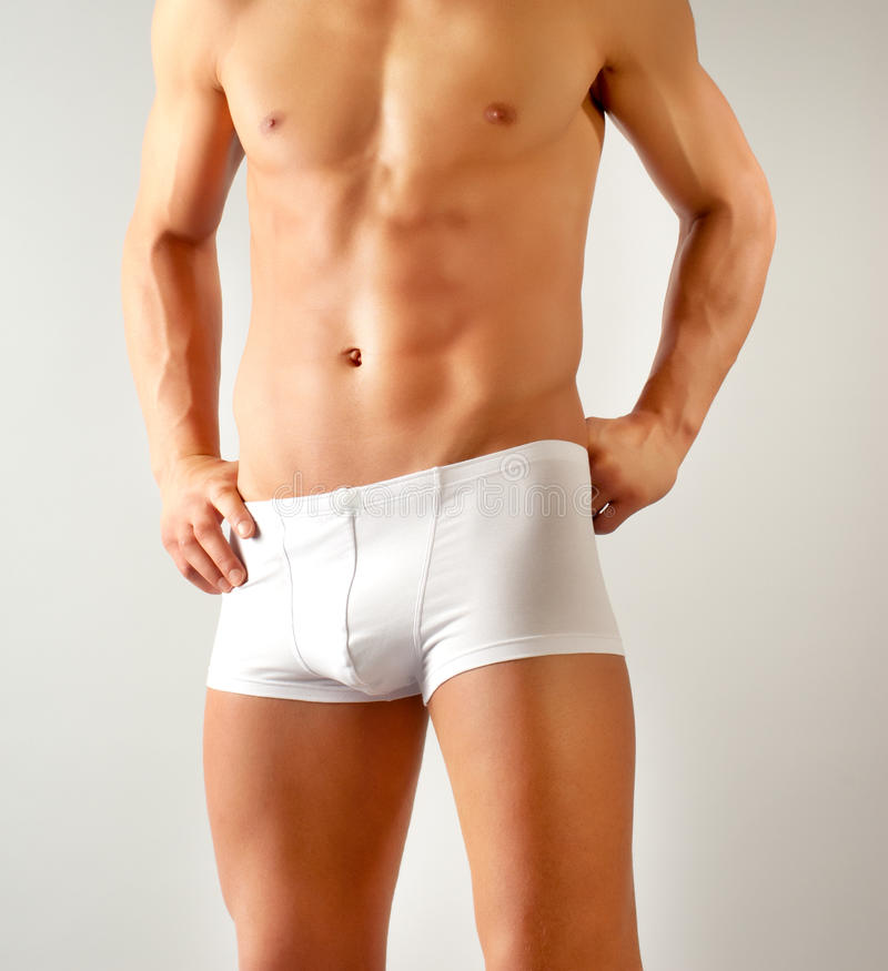 Attractive male body with white underwear stock photography