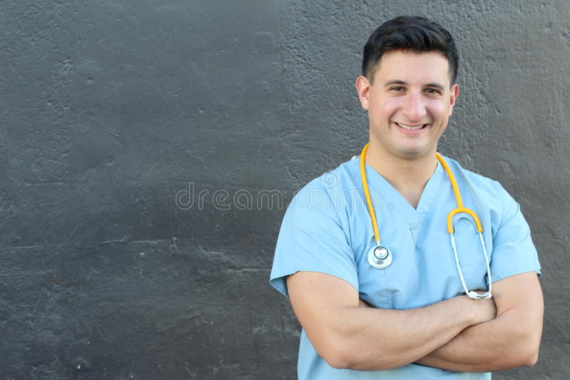Attractive Male Hispanic Doctor or Nurse Isolated with Copy Space.  royalty free stock image