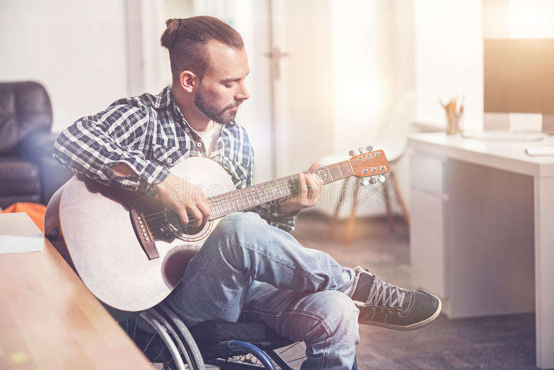 Attractive male person making melody stock photography
