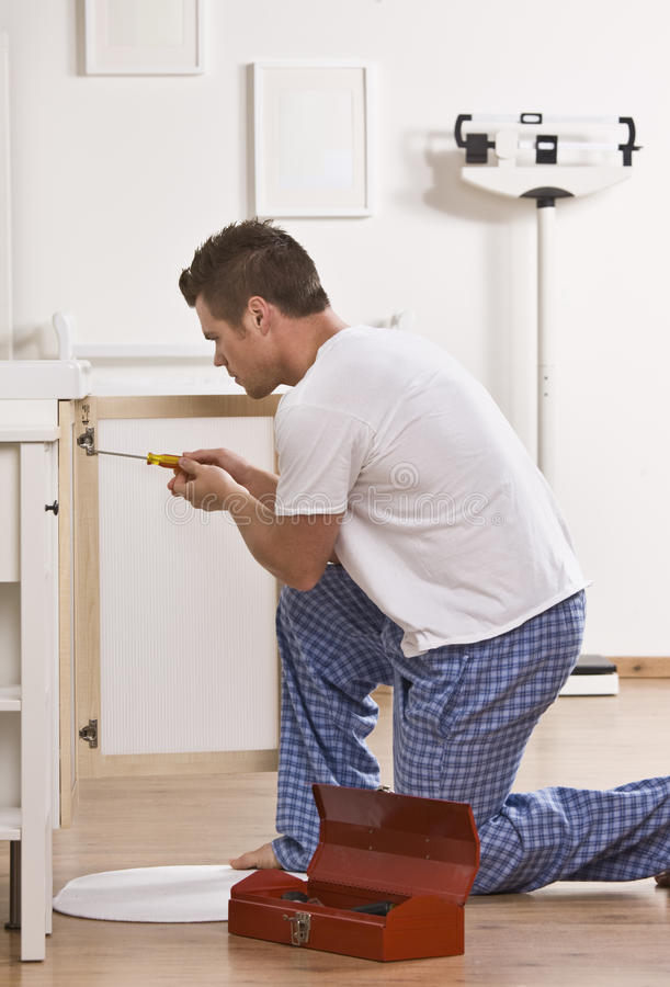 Download Attractive Male With Screwdriver. Royalty Free Stock Photography - Image: 10321147