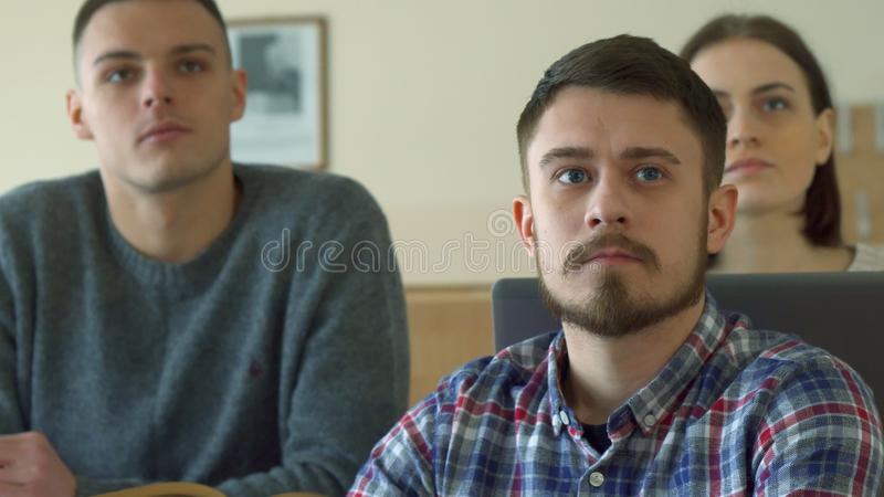 Male student uses digital tablet at the lecture hall stock photos
