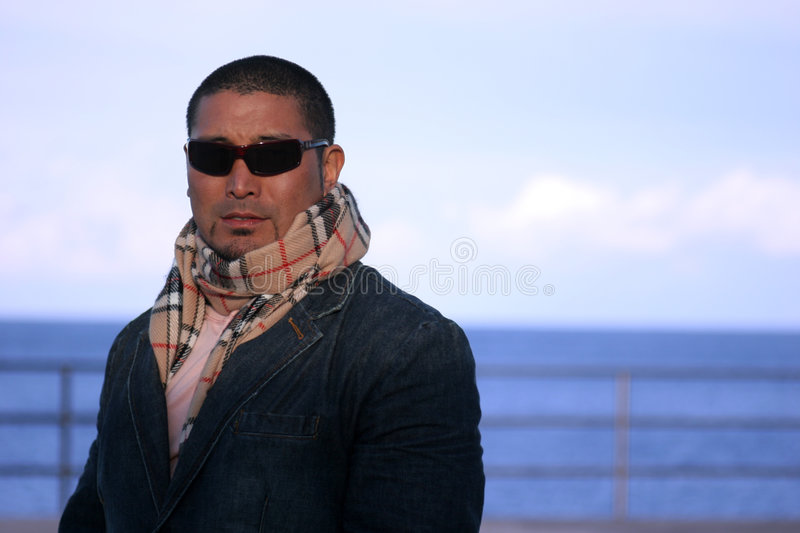 Attractive Man. Outdoor Portrait of an attractive man near the ocean stock image