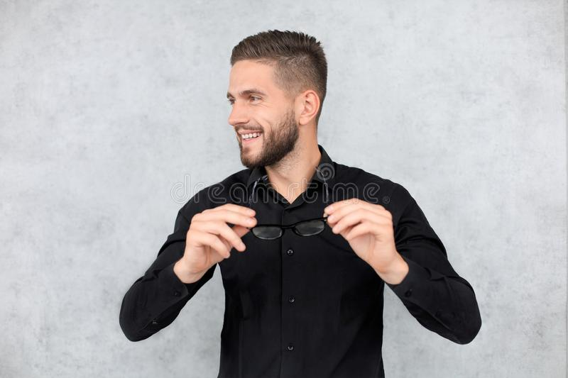 Attractive man dressed casual, wearing glasses - studio shot, copy space stock photos
