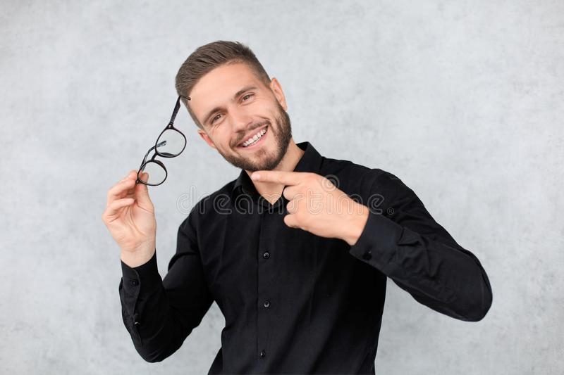 Attractive man dressed casual, wearing glasses - studio shot, copy space royalty free stock photography