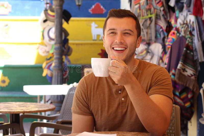 Attractive man enjoying a cup of coffee.  royalty free stock images