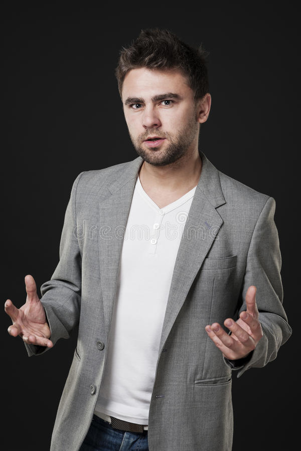 Attractive man explains something stock photos