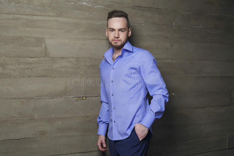 Attractive man in fashionable clothes. Studio shot stock images