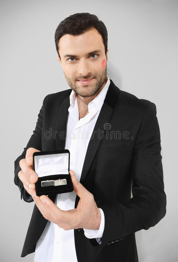 Attractive man holding black box with royalty free stock photos