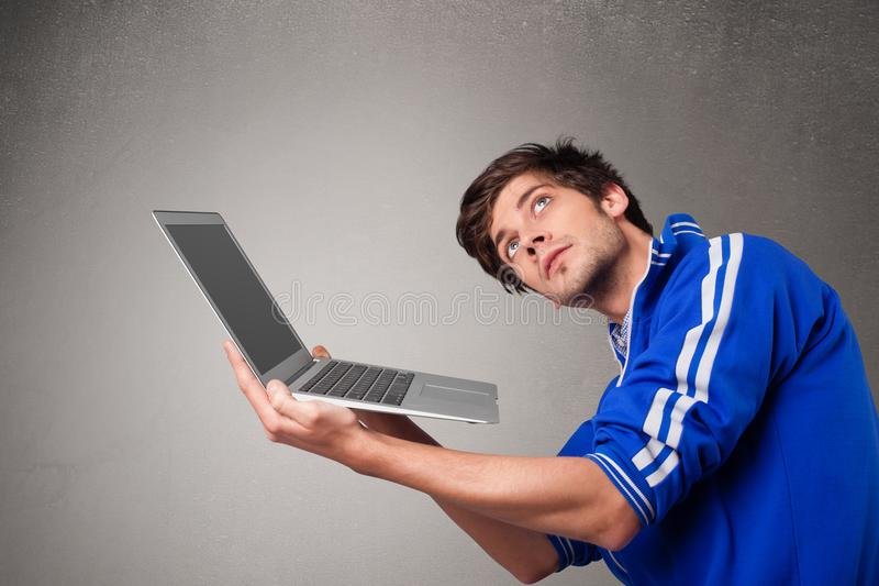 Attractive man holding modern notebook stock image