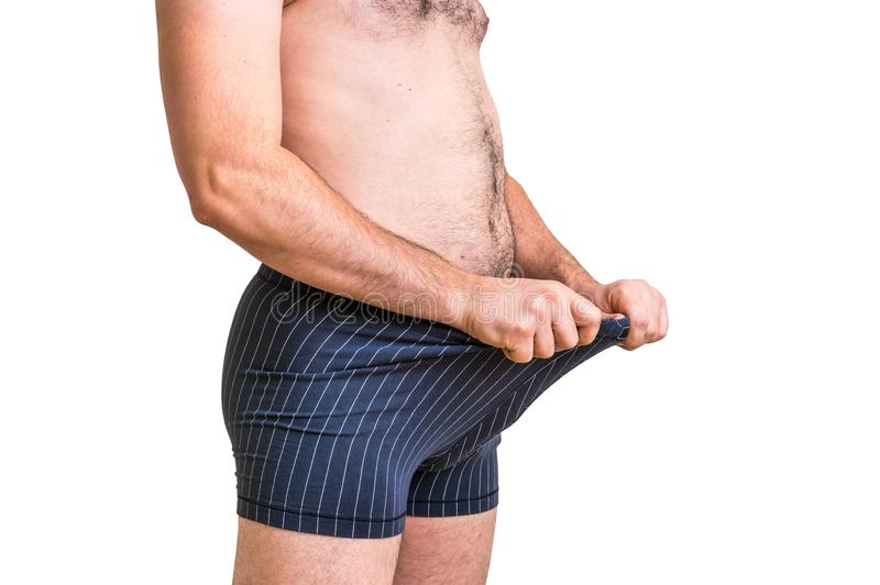 Attractive man is looking in his boxer underwear stock photography