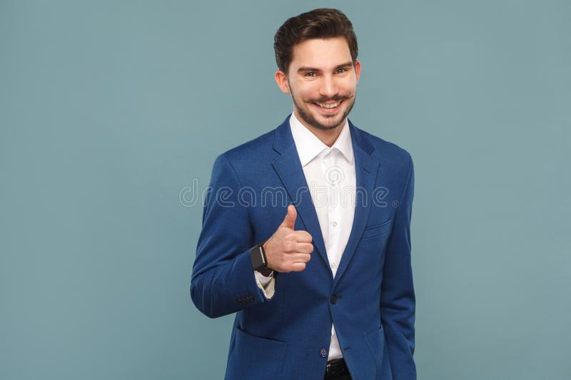 Attractive man with mustache showing like sign at camera royalty free stock photography