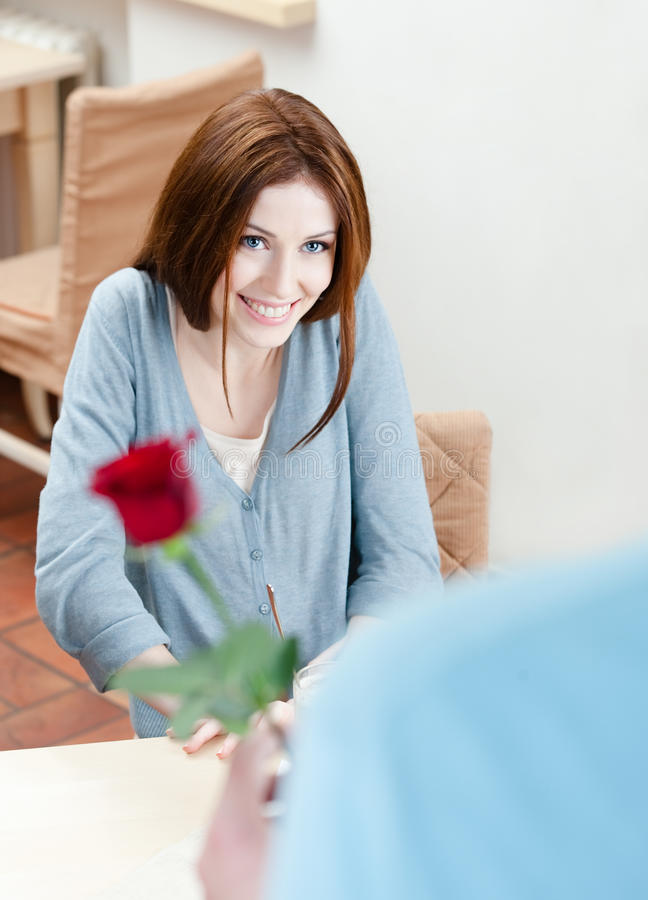 Attractive man presents a scarlet rose royalty free stock photos