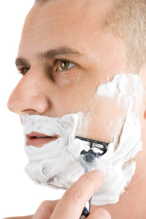 Attractive Man Shaving Royalty Free Stock Photography