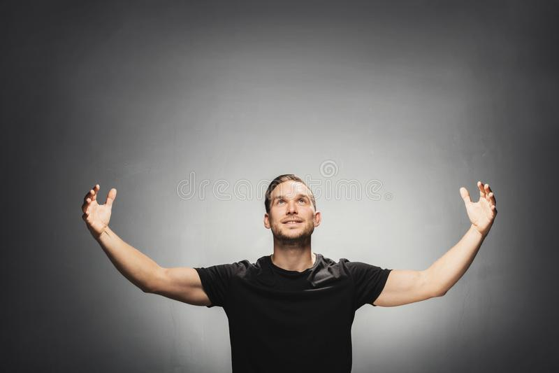 Attractive man smiling, spreading his arms. stock image
