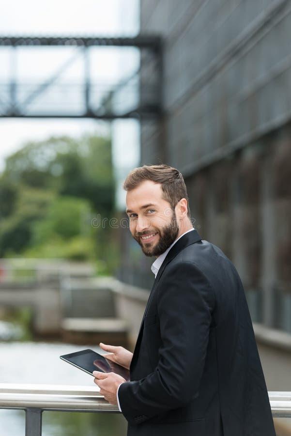 Attractive man standing on an urban bridge stock images