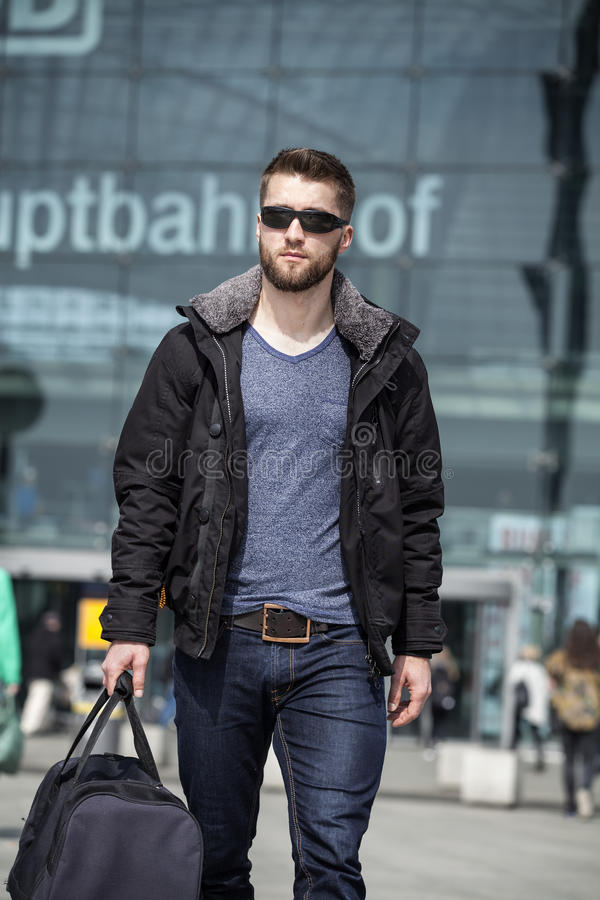 Attractive man with sunglasses and baggage stock image