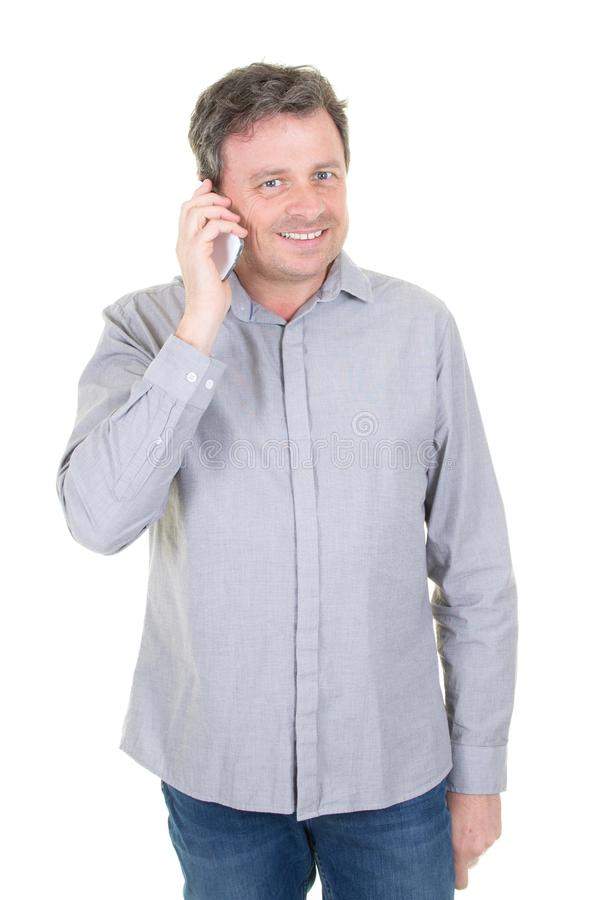 Attractive man talking on the phone and looking away isolated stock images