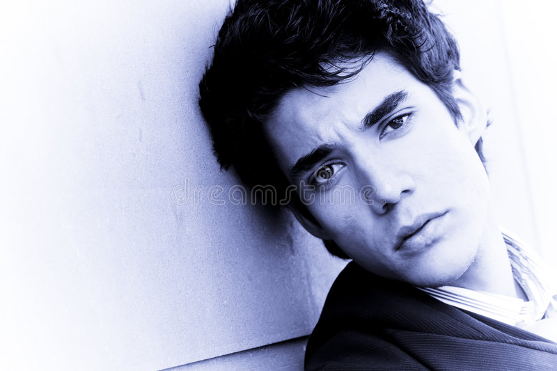 Attractive man on wall stock photos
