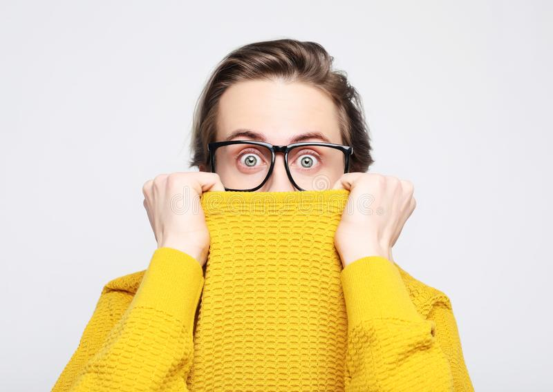 attractive man wearing yellow sweater astonished and amazed in shock and surprise face expression royalty free stock photo