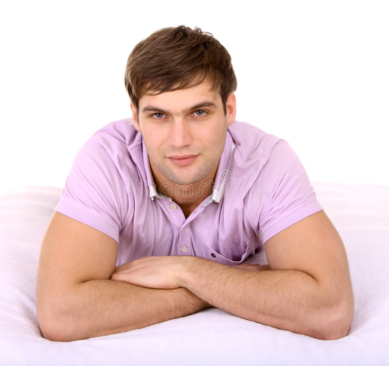 Attractive man on white sheet. royalty free stock photos