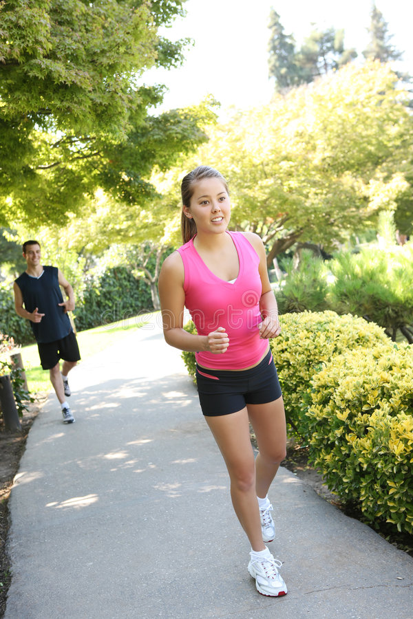 Attractive Man and Woman Couple Jogging royalty free stock photo