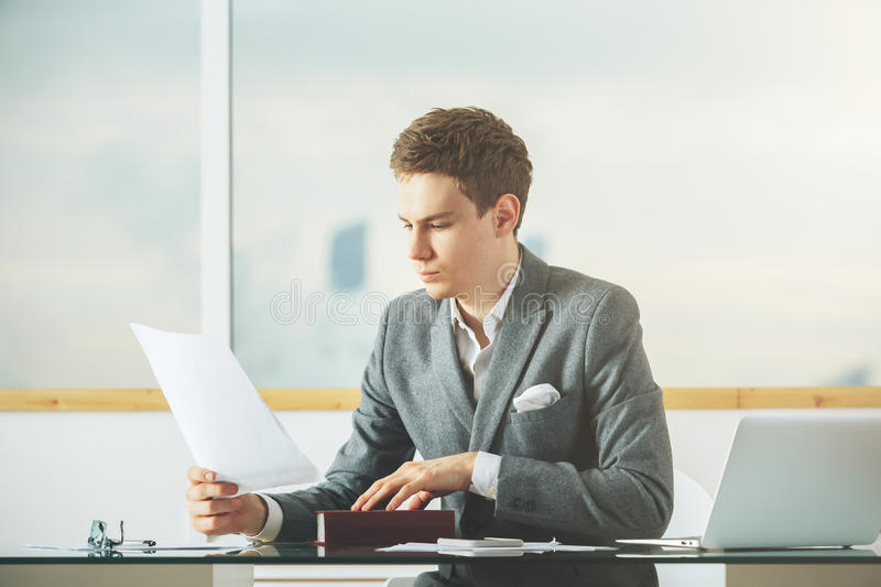 Attractive man working on project royalty free stock photography