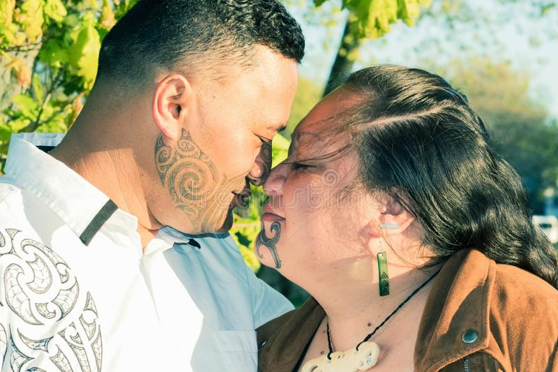 An attractive Maori couple connected in a traditional hongi. Portrait of an attractive Maori couple connected in a traditional hongi royalty free stock photography