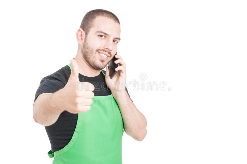 Attractive market seller making like gesture at phone. Isolated on white background with copy space area stock images
