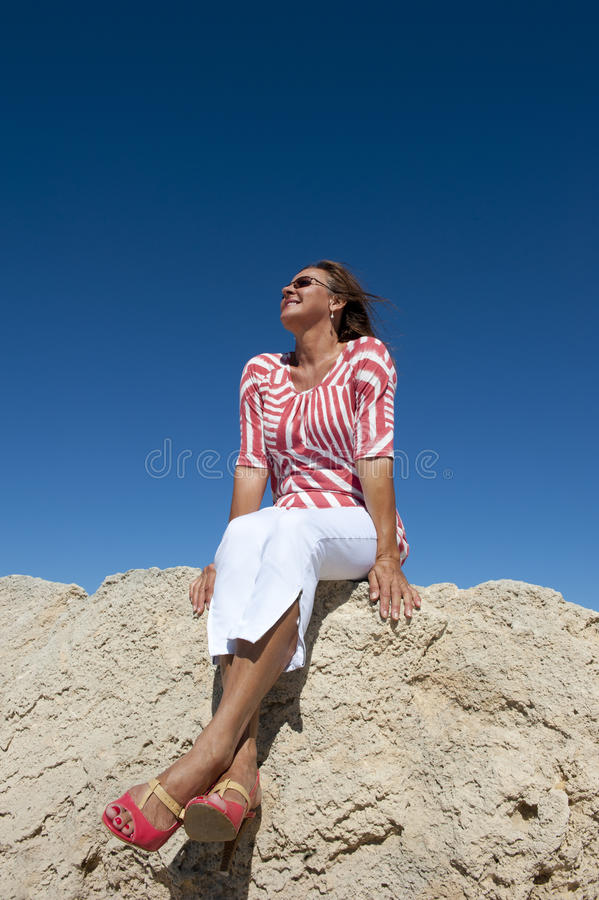 Download Attractive Mature Woman At Seaside Royalty Free Stock Photography - Image: 22568207