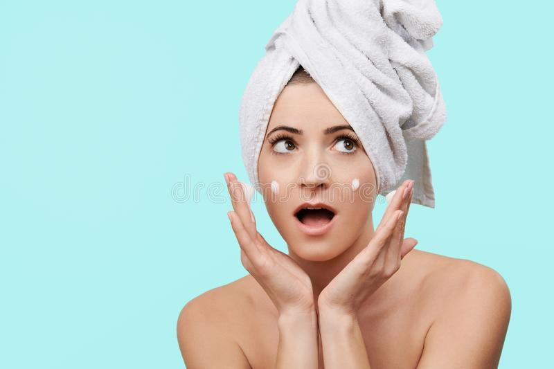 Attractive mid 30s woman using gentle foam facial cleanser. Photo of attractive caucasian woman washing her face. stock photos