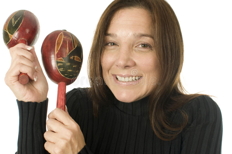 Attractive middle age woman maracas music stock photography