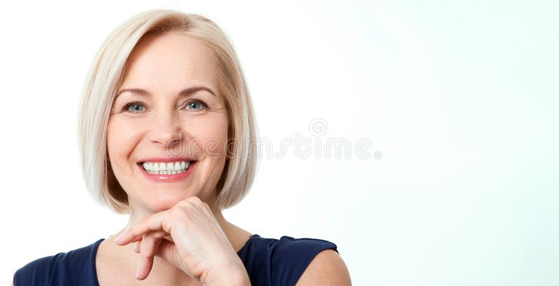 Attractive middle aged woman with beautiful smile on white background royalty free stock images