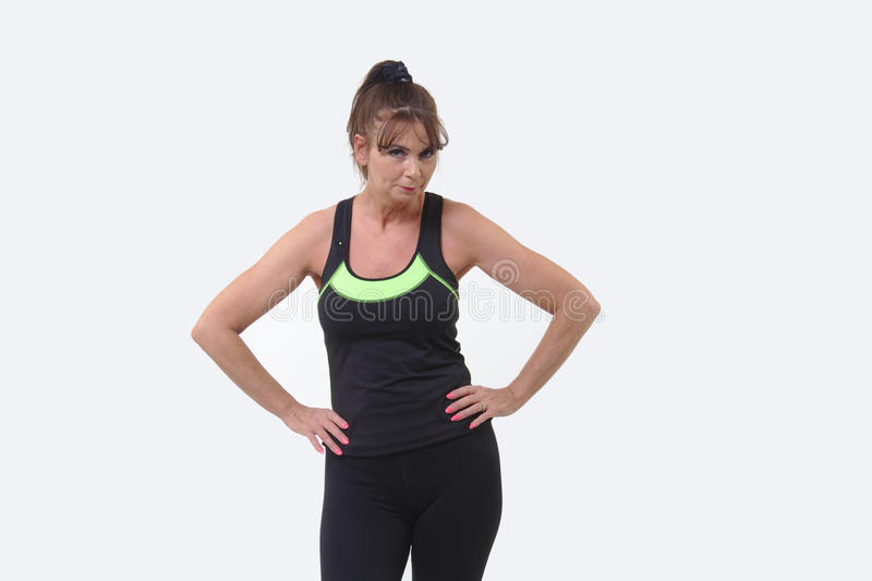 Attractive middle-aged woman in sports gear looking tired royalty free stock photos