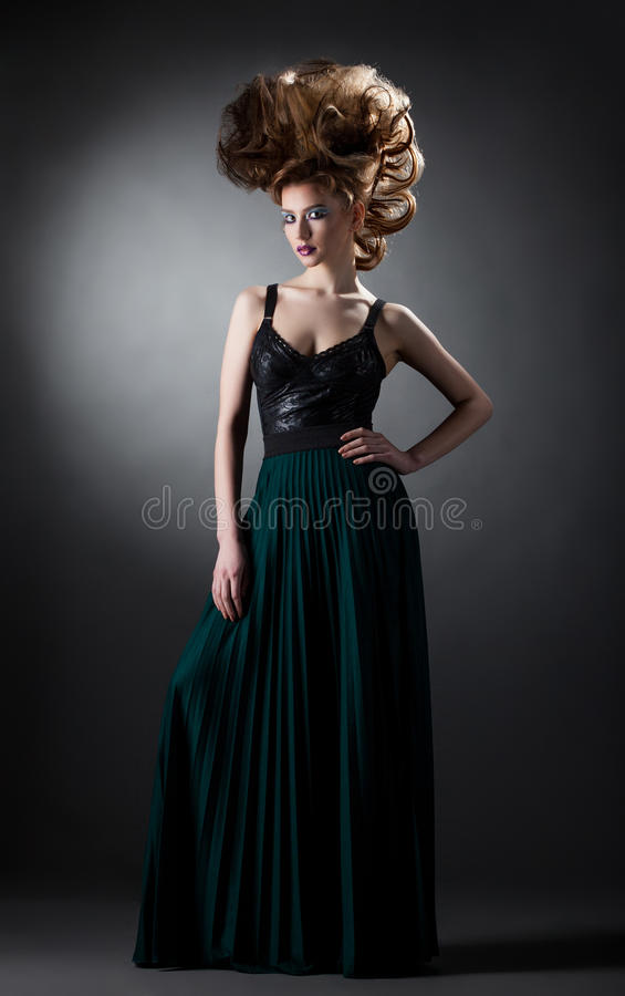 Attractive model posing with creative hairstyle. On gray background royalty free stock images