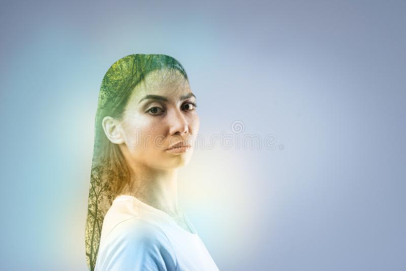 Attractive model standing isolated on grey stock image