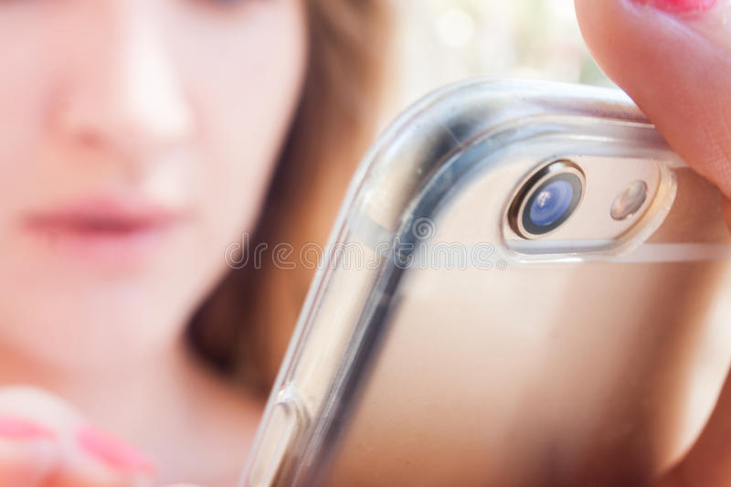 Attractive model woman chatting keyboarding in smartphone royalty free stock images