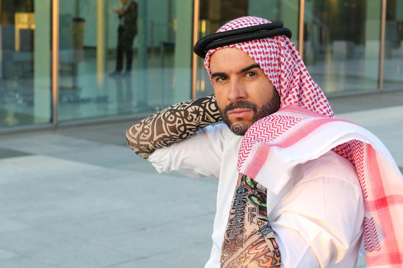 Attractive modern Arabic man looking at camera.  stock photo
