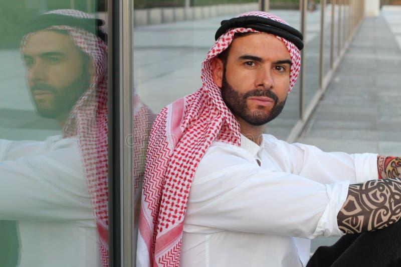Attractive modern Arabic man looking at camera stock image