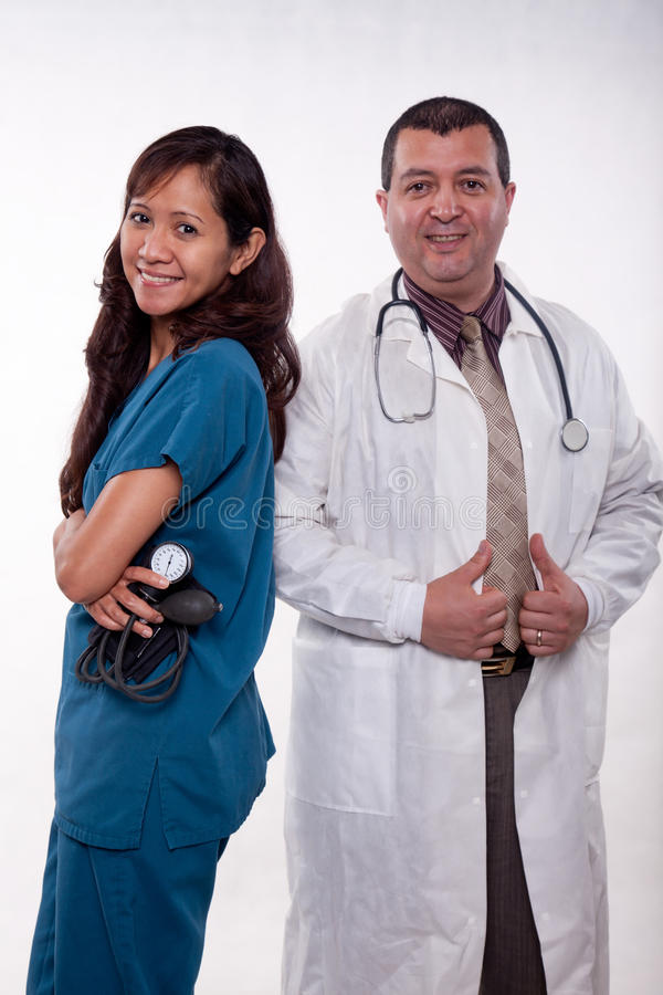 Attractive multi racial medical team. Attractive multi racial medical man and woman team stock photo