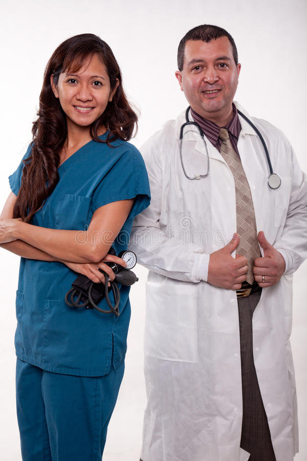 Attractive multi racial medical team. Attractive multi racial medical man and woman team royalty free stock images