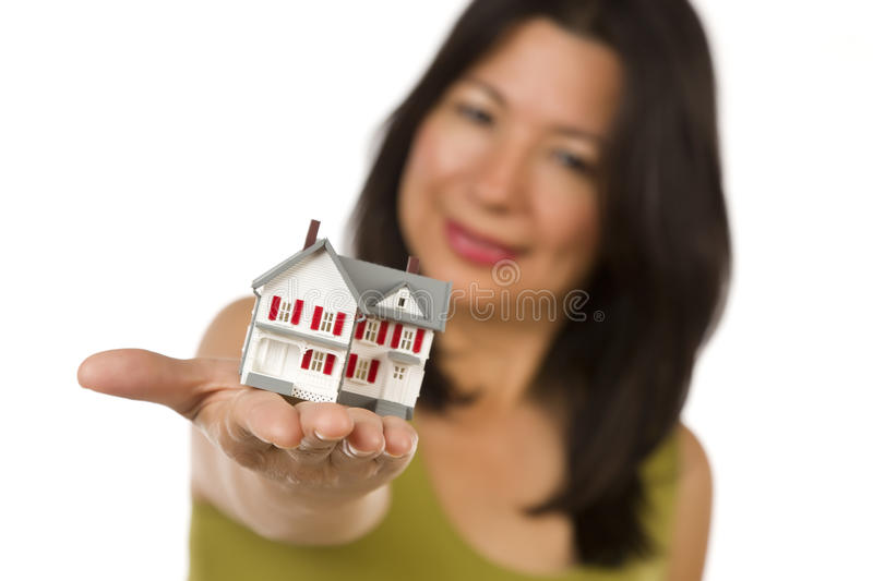 Attractive Multiethnic Woman Holding Small House stock photos